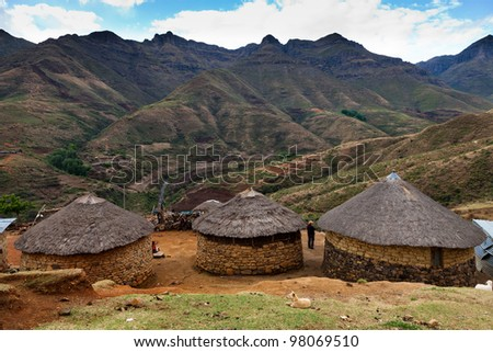 Small village in the mountains in the evening - stock photo