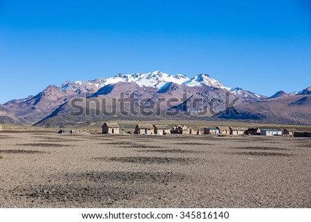Small village of shepherds of llamas in the Andean mountains. High Andean tundra landscape in the mountains of the Andes.  - stock photo