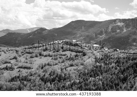 Small village on the hill. Alpine landscape in Provence-Alpes-Cote d'Azur region of France. Black and white photo. - stock photo