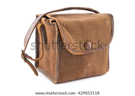 Small Vintage Brown Canvas Camera Bag over white. - stock photo