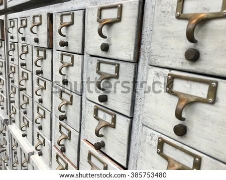 small vintage white drawers  - stock photo