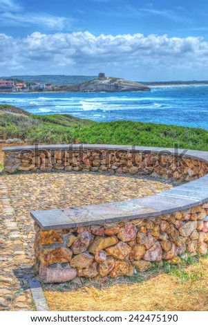small wall by the shore in Sardinia - stock photo