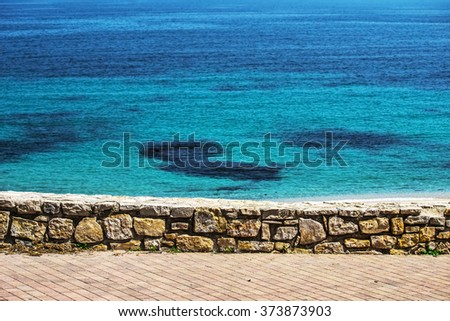 small wall by the shore in Sardinia, Italy