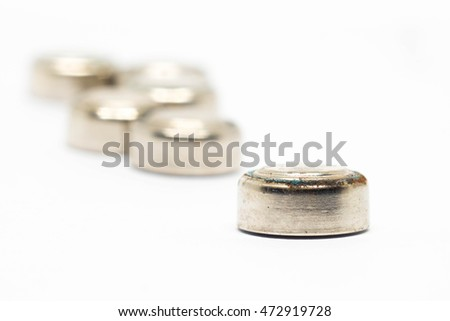 small watch rusty batteries isolated on white background