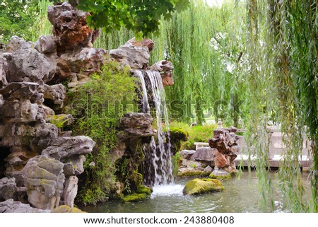 small waterfall in beautiful park - stock photo