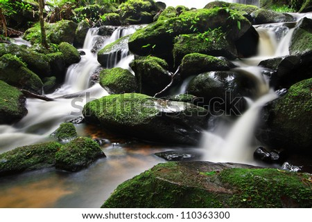 Small Waterfall in deep forest - stock photo