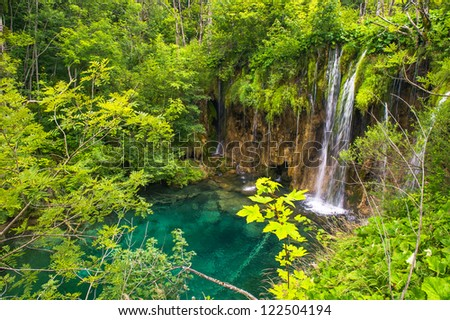 Small waterfall in summer on a sunny day . Plitvice Lakes National Park, the largest national park in Croatia founded in 1949 - stock photo