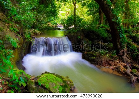 Small waterfall in the forest of Thailand.