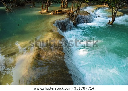 Small waterfall in the Laos jungle on sunny day - stock photo