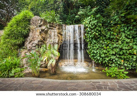 Small waterfall in the park - stock photo