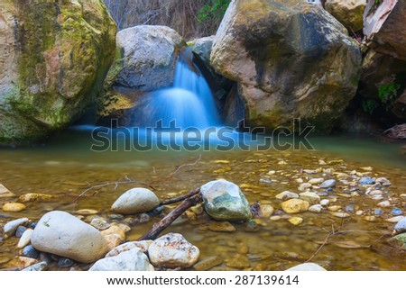 small waterfall on a mountain river - stock photo