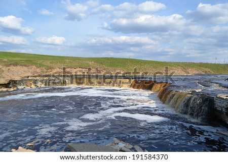 Small waterfall on Tosna River, Leningrad Region, Russia.
