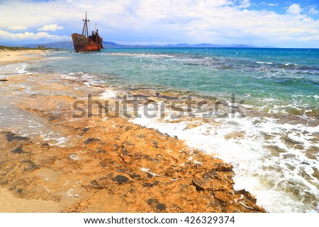 Small waves and remote shipwreck near the sea shore in Gythio, Greece