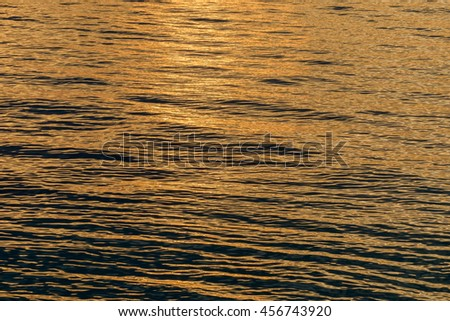 Small waves and tide washing up on the Dry Tortugas beach in the Gulf of Mexico at sunset - stock photo