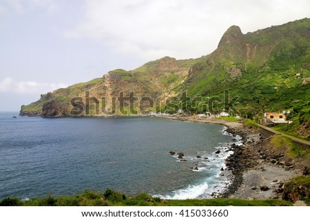 Small waves crash against the pebble beach of Fajan D'Agua, a popular tourist destination on the island of Brava, Cabo Verde