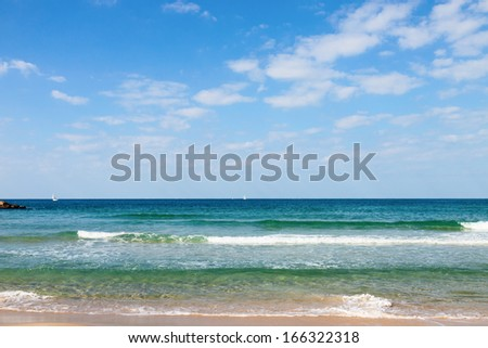 Small waves on Mediterranean Sea in Israel - stock photo