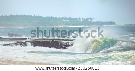 Small waves on the background of a tropical island's shore