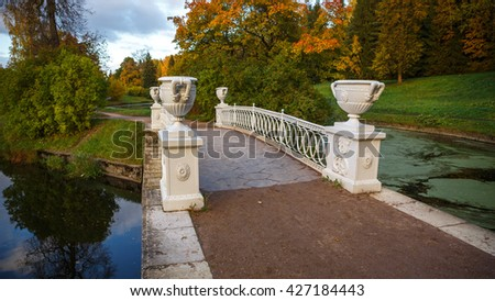 Small white bridge in the old park