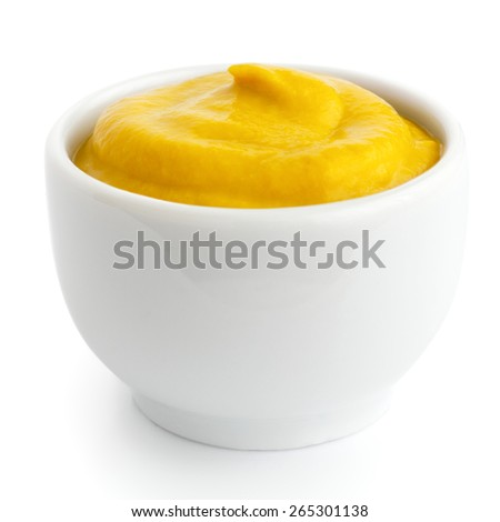Small white ceramic dish of American mustard. Isolated.