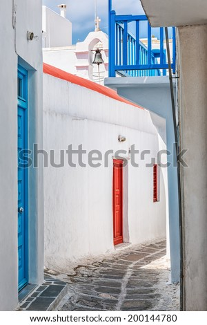 Small white chapel in an alley of Chora in Mykonos, Cyclades, Greece - stock photo