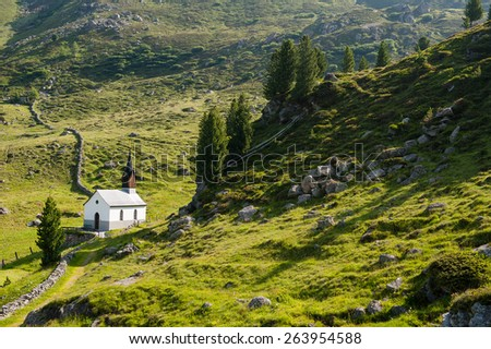 Small white church in swiss alps