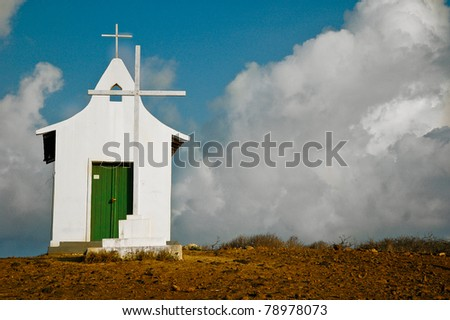 Small White Church with Cross on a Hill
