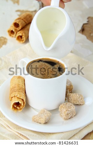 small white cup of strong espresso coffee