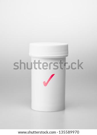 Small white medecine bottle - stock photo