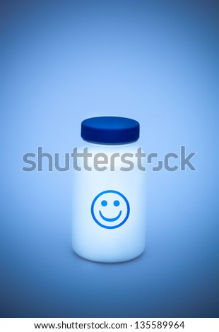 Small white medecine bottle with blue lid - stock photo
