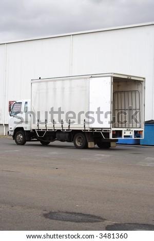 Small white truck - stock photo