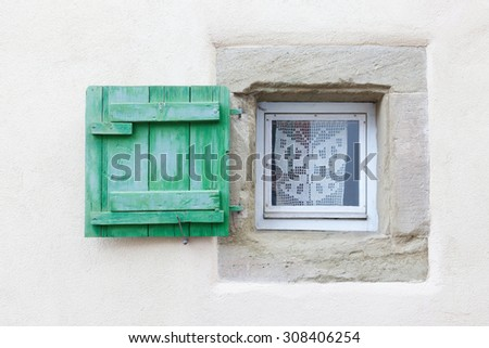 Small window and wooden shutter - stock photo