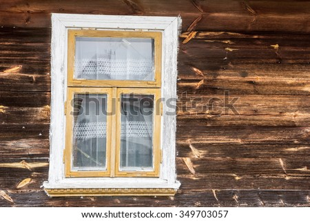 Small window in wooden village house cottage.