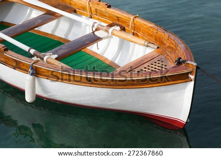 Small wooden boat - stock photo