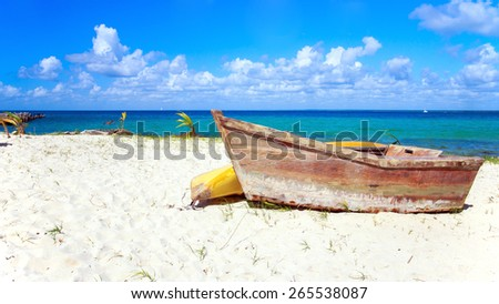Small wooden boat on caribbean beach in Dominican Republic