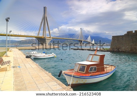 Small wooden boats take cover inside Antirrio harbor, Greece - stock photo