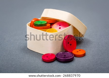 Small wooden box with colorful vintage buttons - stock photo