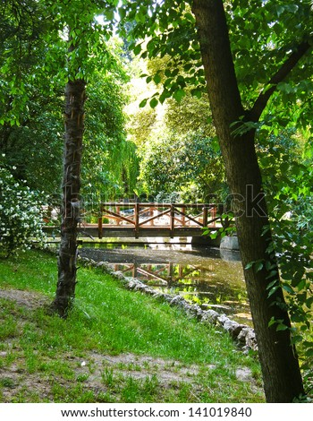 Small wooden bridge in old park Buen Retiro in Madrid - stock photo