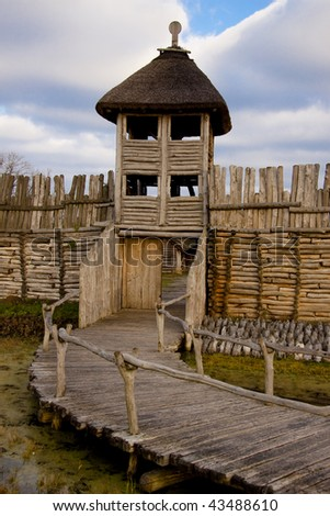 Small wooden bridge, wall and tower in Biskupin - Poland