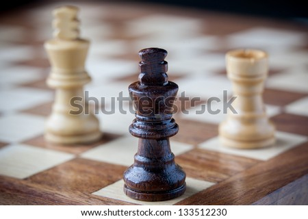 Small wooden chess pieces - stock photo