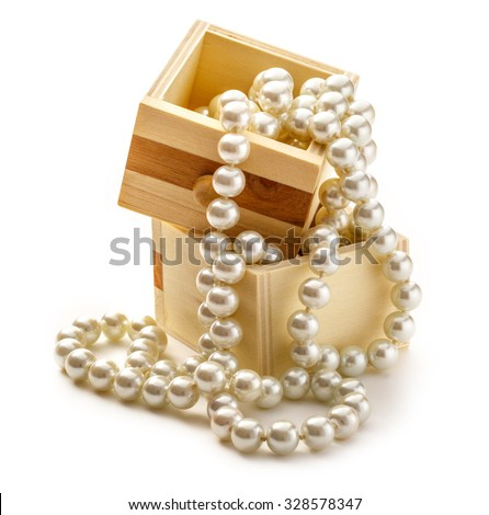 Small wooden chest with white pearl necklace