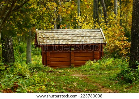 Small wooden house in the forest - stock photo