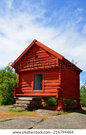 Small wooden red house.  Aland Islands, Finland - stock photo