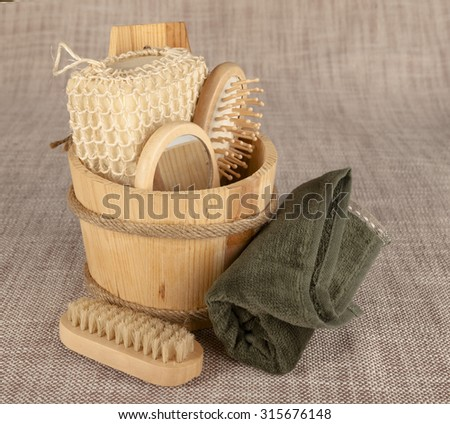 Small wooden spa set with sponge,  pumice stone, a mirror, towel, brush comb. - stock photo