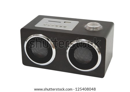 Small wooden speaker or player isolated on white background - stock photo