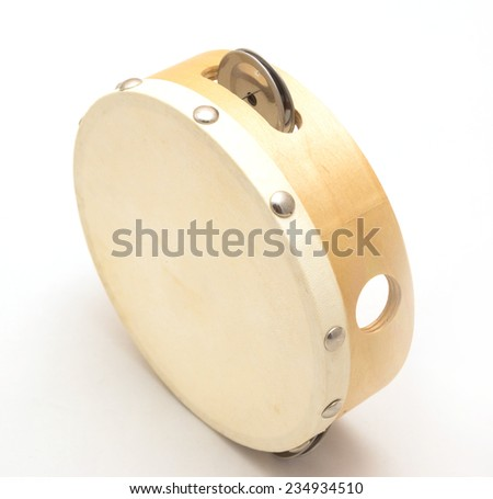 Small wooden tambourine with white leather drum isolated on white - stock photo