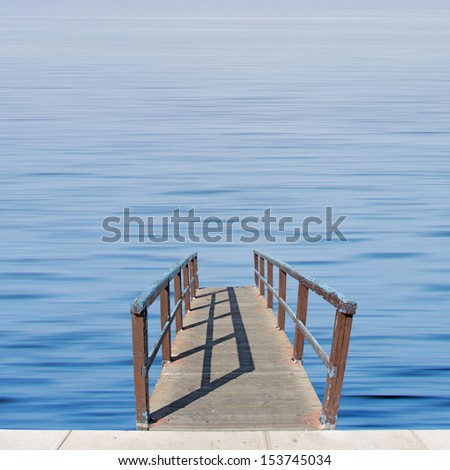 Small wooden while over calm blue sea