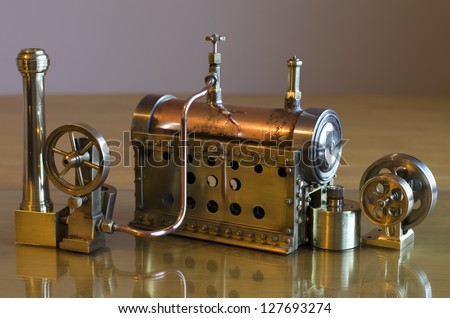 Small working model steam engine and boiler - stock photo