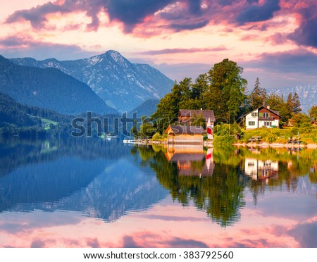 Small yacht dock in Gessl village. Misty morning on the lake Grundlsee, Alps, Austria, Europe. - stock photo
