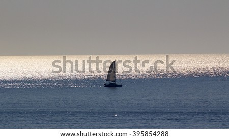 Small yacht in the morning sea