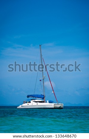 Small yacht  in the sea with blue sky at Thailand - stock photo